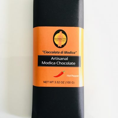 A photo of a chocolate candy bar of Handmade Modica chocolate from Sicily made with hot pepper